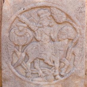 Horse rider using stirrups
